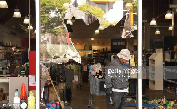 A workers cleans up at a BevMo on La Cienega Boulevard on Sunday May 31 2020