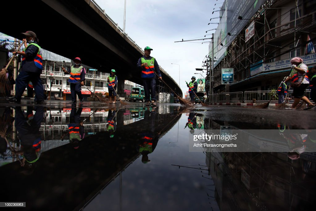 Workers clear an area near Victory Monument after it was attacked during clashes by anti-government 'Red shirt' protesters and Thai security forces on May 22, 2010 in Bangkok, Thailand. Thai Prime Minister Abhisit Vejjajiva says order has been restored to the capital Bangkok and throughout the country. A night-time curfew remains in place in Bangkok and 23 provinces accross Thailand in a bid to prevent a resurgence of unrest. At least 44 people have been killed in clashes in which protesters clashed with military forces over a period of six consecutive days, resulting in the end of the blockade and the surrender of Red-shirt leaders.