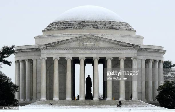 Workers clear snow from the Jefferson Memorial on March 17 2014 in Washington DC The Washington DC area was hit with 46 inches of snow on St...