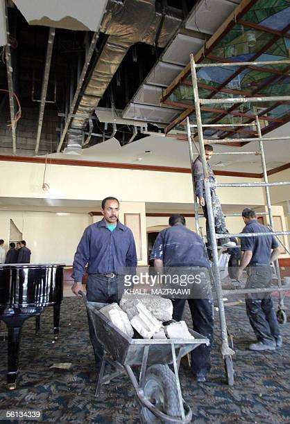 Workers clear up the rubble at Amman's Radisson SAS hotel 10 November 2005 one day after a deadly attack on it Jordan said it had arrested several...