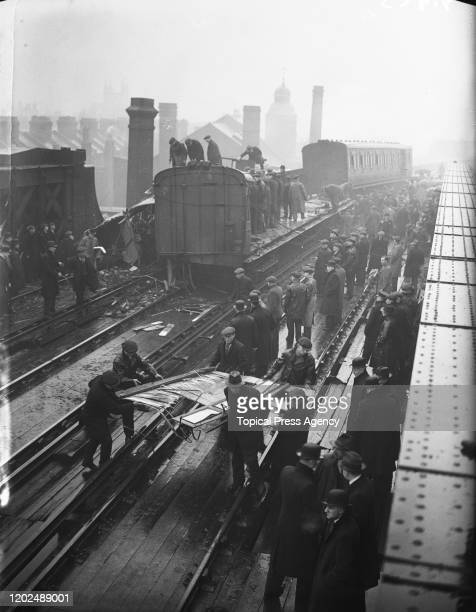 Workers clearing away wreckage in the aftermath of the Battersea Park rail crash near Battersea Park railway station in London 2nd April 1937 A...