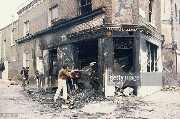 Workers clearing debris from a burntout welding shop in Railton Road Brixton south London after the first Brixton riot 13th April 1981