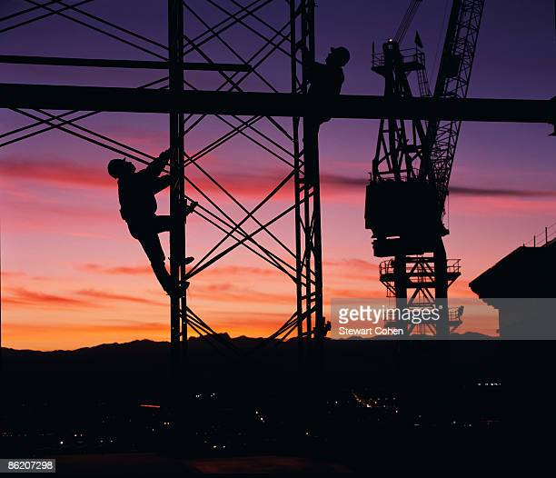 Workers climbing towers of construction site in Las Vegas