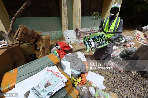 Workers collect electoral materials at the headquarters of Independent National Electoral Commission in Kano Nigeria on February 14 2019 Electoral...