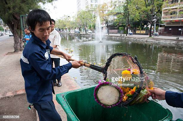 Workers collect krathong out of Chiang Mai's moat after the Loy Krathong festival. Every year, about 600 tons of Krathong are released into the Ping...