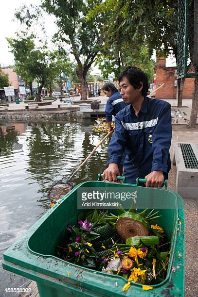 Workers collect krathongs out of Chiang Mai's moat at the Tapae gate during the Loy Krathong festival. Every year, about 600 tons of Krathong are...