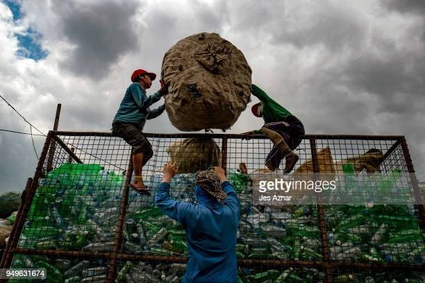 Workers collect plastic bottles in a village that thrives on waste segregation for a living on April 18 2018 in Manila Philippines The Philippines...
