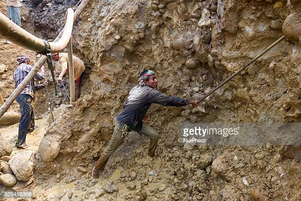 Workers collecting stones at the stone extraction site in Jaflong Sylhet Bangladesh on February 28 2015 Sylhet is a very resourceful place of...