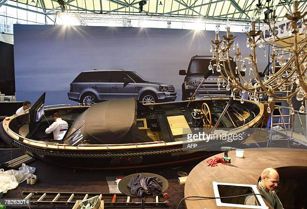 Workers complete the final details on exhibits at the Miljonair Fair 2007, 05 December 2007 on the eve of its opening day in Amsterdam. AFP...