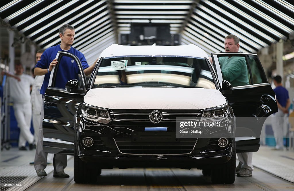 Workers conduct final inspections and prepare finished Volkswagen cars for transport at the end of the assembly line prior to a visit by Volkswagen Group Chairman Matthias Mueller and Lower Saxony Governor Stephan Weil at the Volkswagen factory on October 21, 2015 in Wolfsburg, Germany. The two toured the plant and met with workers as Volkswagen continues to struggle through the wake of the Volkswagen diesel emissions scandal. The company installed software that cheats during emissions test into 11 million of its diesel cars sold worldwide.
