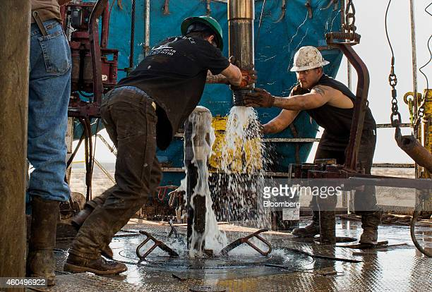 Workers connect drill bits and drill collars used to extract natural petroleum on Endeavor Energy Resources LP's Big Dog Drilling Rig 22 in the...