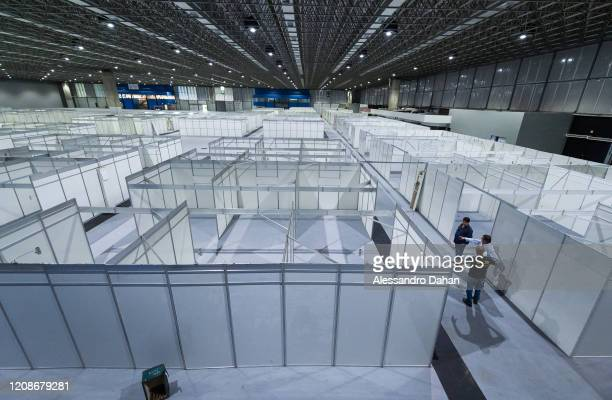 Workers construct a field hospital in Riocentro Convention Center on March 30 2020 in Rio de Janeiro Brazil The facility is being set up with 500...