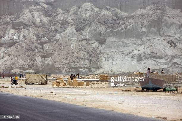 Workers construct a sidewalk on Marine Drive in Gwadar Balochistan Pakistan on Tuesday July 4 2018 What used to be a small fishing town on the...