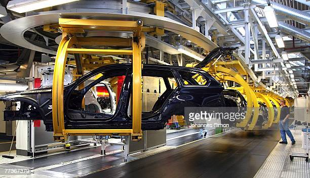 Workers construct BMW 3 series cars in the Munich BMW plant during a guided tour after the opening ceremony of BMW World on October 17 2007 in Munich...