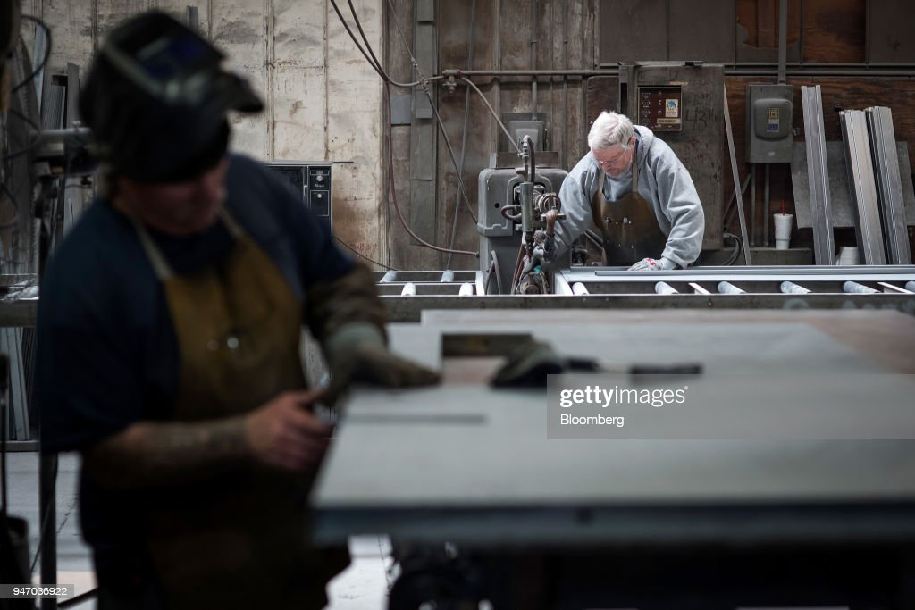 Workers construct doors at the Metal Manufacturing Co. facility in Sacramento, California, U.S., on Thursday, April 12, 2018. The Federal Reserve is scheduled to release industrial production figures on April 17. Photographer: David Paul Morris/Bloomberg via Getty Images