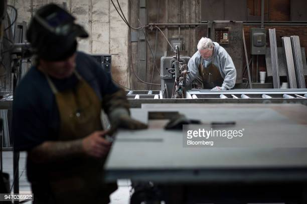 Workers construct doors at the Metal Manufacturing Co facility in Sacramento California US on Thursday April 12 2018 The Federal Reserve is scheduled...