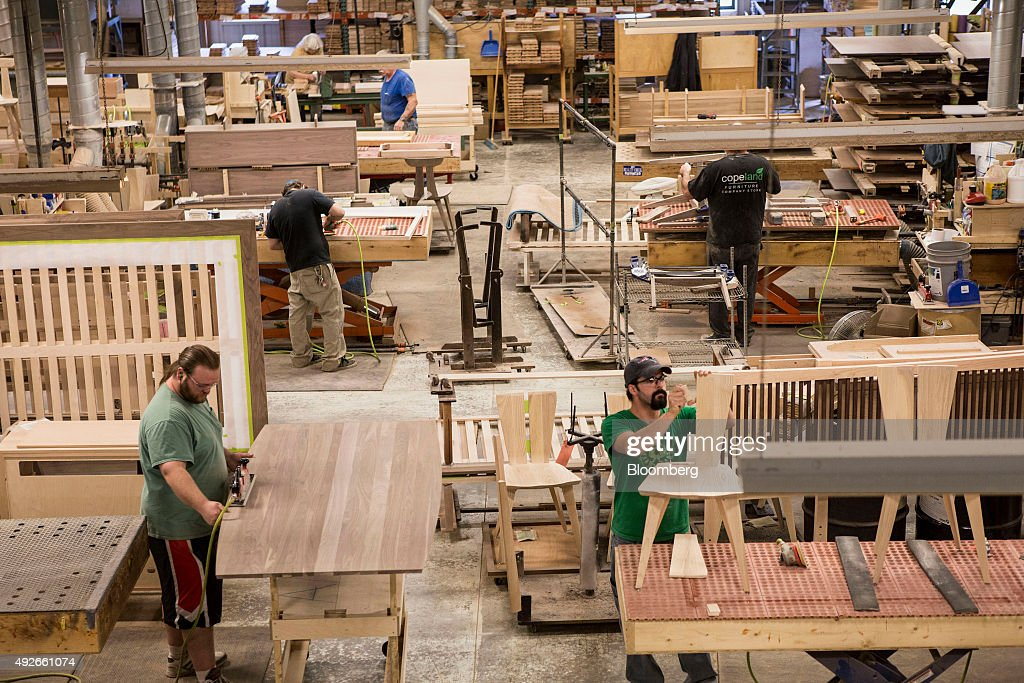 Workers construct furniture from wood at the Copeland Furniture  manufacturing facility in Bradford  Vermont. Inside The Copeland Furniture Manufacturing Facility As Business