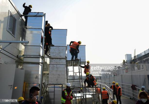 WUHAN CHINA FEBRUARY 3 2020 Workers construct huoshenshan hospital Wuhan Hubei Province China February 3 2020 PHOTOGRAPH BY Costfoto / Barcroft Media