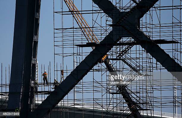 Workers construct scaffolding on a tower of the old eastern span of the San FranciscoOakland Bay Bridge during a tour of the demolition site on March...