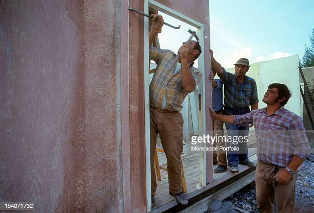 Workers construct temporary houses for displaced earthquake FriuliVenezia Giulia May 1976