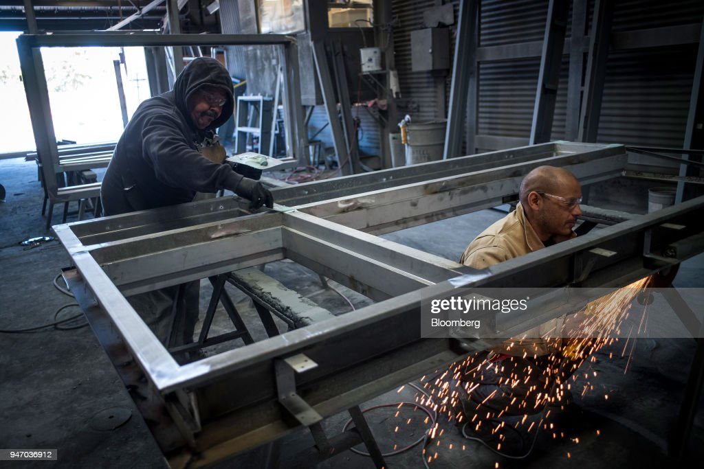 Workers construct window frames at the Metal Manufacturing Co. facility in Sacramento, California, U.S., on Thursday, April 12, 2018. The Federal Reserve is scheduled to release industrial production figures on April 17. Photographer: David Paul Morris/Bloomberg via Getty Images