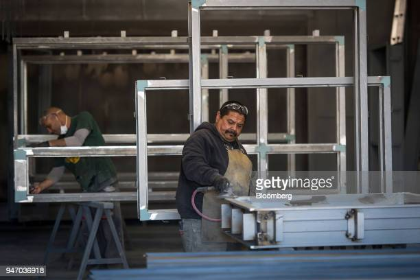Workers constructs windows at the Metal Manufacturing Co facility in Sacramento California US on Thursday April 12 2018 The Federal Reserve is...