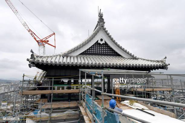 Workers continue restoration work of the damaged Kumamoto Castle keep on June 26 2018 in Kumamoto Japan The castle was heavily damaged by the strong...