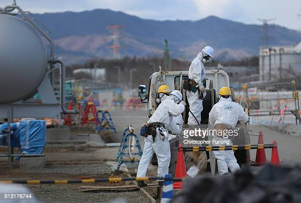 Workers continue the decontamination and reconstruction process at the Tokyo Electric Power Co's embattled Fukushima Daiichi nuclear power plant on...