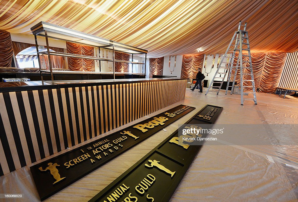 Workers continue to build the tent for the 19th Annual Screen Actor Guild Awards after party during behind the scenes event at The Shrine Auditorium on January 25, 2013 in Los Angeles, California.