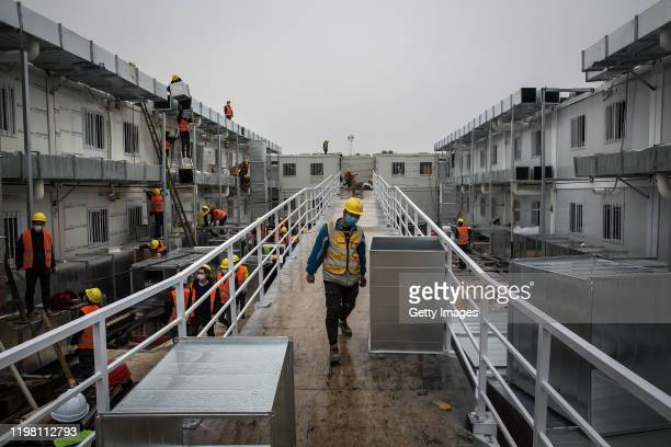 Workers continue to build Wuhan Huoshenshan Hospital on February 2 2020 in Wuhan China Built in response to the coronavirus outbreak and with the...
