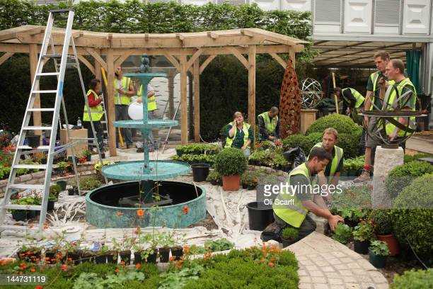 Workers continue to prepare for the opening of the Royal Horticultural Society's Chelsea Flower Show on May 18, 2012 in London, England. The...
