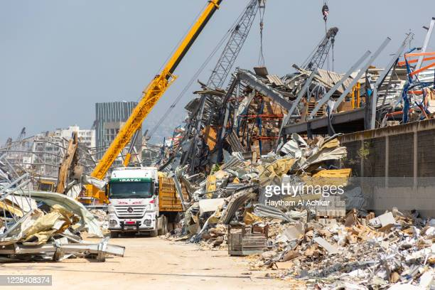 Workers continue to remove debris damaged cars and destroyed warehouses from last month's explosion at the Ports Free Zone on September 8 2020 in...