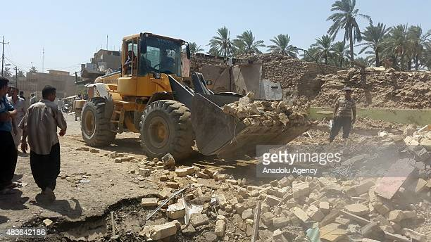 Workers continue to remove the wreckages and debris after bombing attack occurred yesterday in Baqubah region of Diyala Iraq on August 11 2015 At...