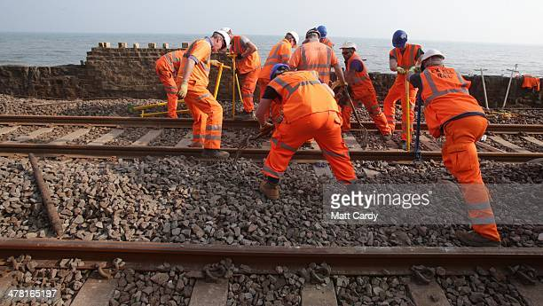 Workers continue to repair the main Exeter to Plymouth railway line that has been closed since February 5 due to parts of it being washed away by the...