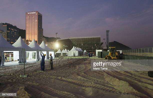 Workers continue with preparations at the Olympics site for beach volleyball continue on Copacabana beach on July 14 2016 in Rio de Janeiro Brazil...