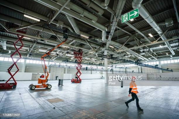 Workers convert a trade fair hall into a hospital for treating Covid19 patients at the Messe Berlin trade fair grounds on April 1 2020 in Berlin...