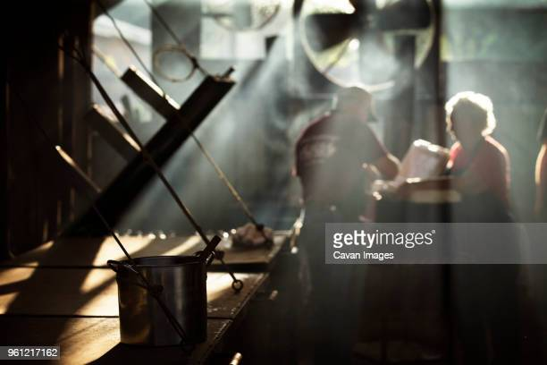 workers cooking food in kitchen at restaurant - working seniors stock pictures, royalty-free photos & images