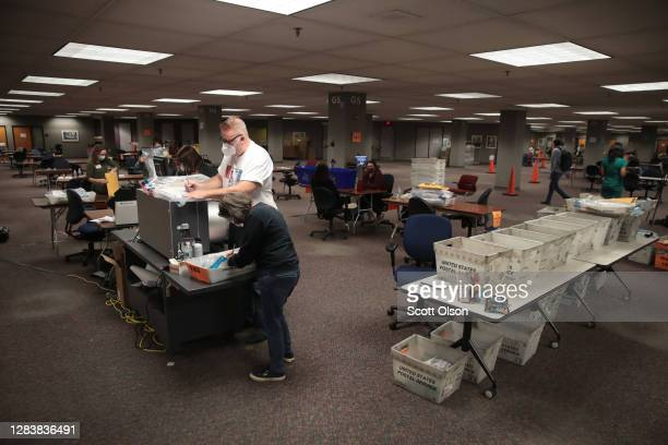 Workers count absentee ballots on November 04, 2020 in Milwaukee, Wisconsin. Wisconsin requires election officials to wait to begin counting absentee...