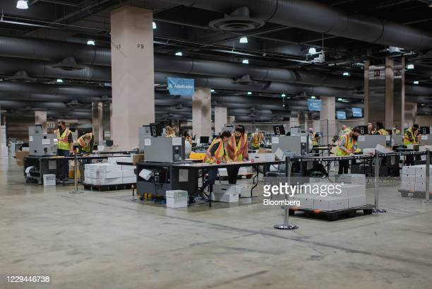 Workers count ballots for the 2020 Presidential election at the Philadelphia Convention Center in Philadelphia, Pennsylvania, U.S., on Tuesday, Nov....