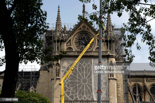 Workers cover and protect the Rosette of NotreDame de Paris Cathedral in Paris on April 22 seven days after a fire devastated the cathedral French...