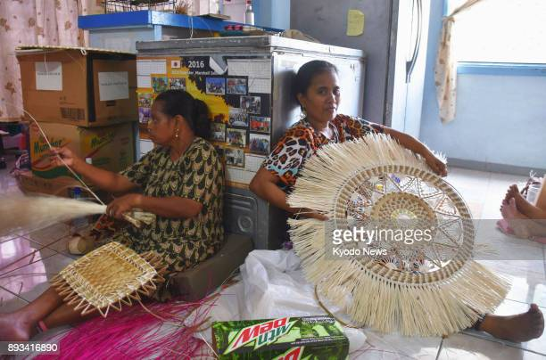 Workers create traditional handicrafts at a shop in Majuro the Marshall Islands on Nov 29 2017 While the Marshallese had a handicraft tradition...