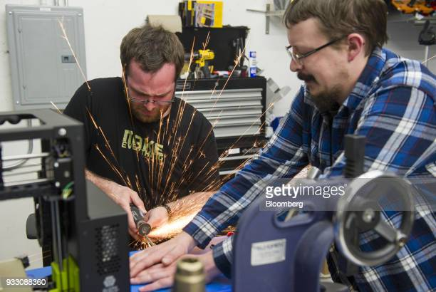 Workers cut a guide rod during production of a LulzBot 3D printer at the Aleph Objects Inc facility in Loveland Colorado US on Wednesday March 14...