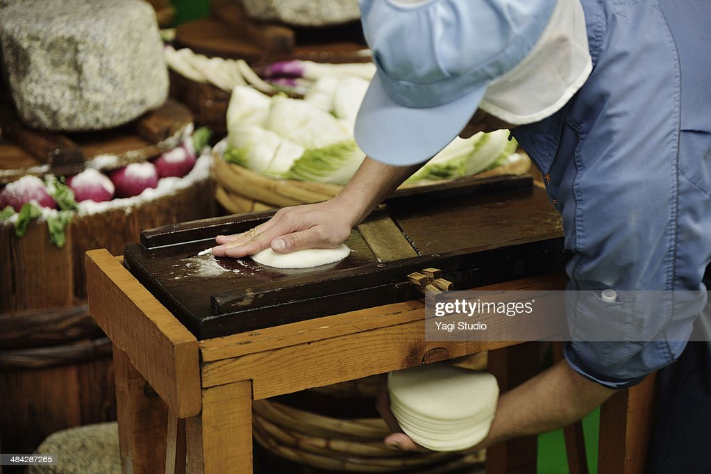 Workers cutting turnip in factory of pickles : Stock Photo