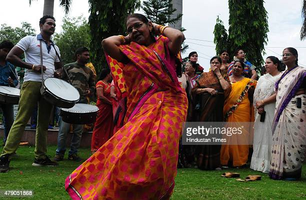 BJP workers dancing to celebrate victory in Garoth by election on June 30 2015 in Bhopal India Bharatiya Janata Party candidate Chander Singh Sisodia...