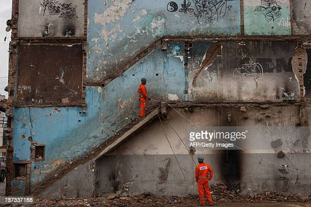 Workers demolish an abandoned building where the drug addicts used to live as part of the city's cleanup project of the area known as 'Cracolandia'...