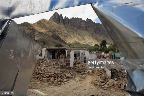 Workers demolish an old Tibetan neighborhood which is being torn down to make the valuable land available for commercial usage on August 5 2006 in...