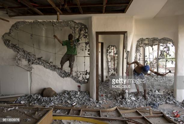 Workers demolish the walls of the West Cove Hotel on the Philippine island of Boracay on April 26 2018 The Philippines shuttered its most famous...