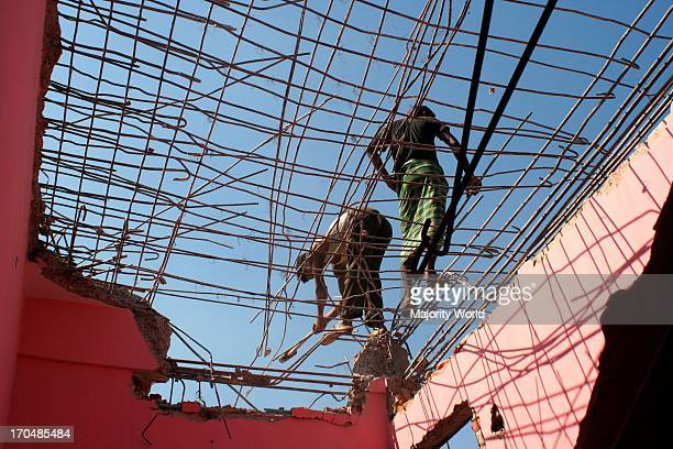 Workers demolishing buildings to make way for new ones The construction industry has boomed in major cities of Bangladesh with many new buildings...