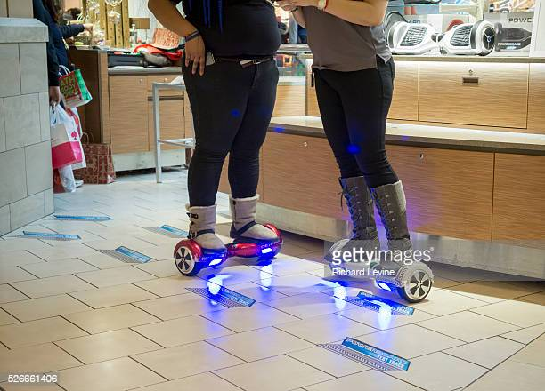 Workers demonstrate hoverboards the Queens Center Mall in the borough of Queens in New York on the socalled Super Saturday December 219 2015 Super...