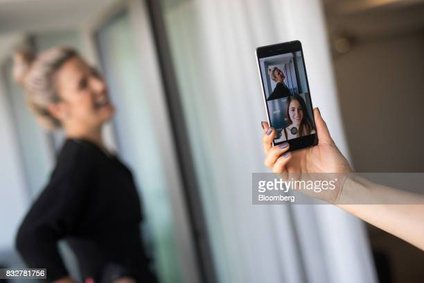 Workers demonstrate the front and rear cameras on the Nokia 8 smartphone designed by HMD Global Oy ahead of its official unveiling in London UK on...